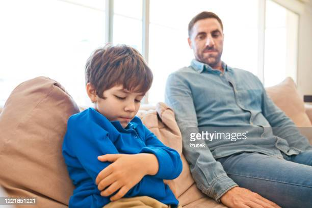 conflict between father and son - anger stock pictures, royalty-free photos & images