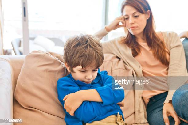 conflict between mother and son - son stock pictures, royalty-free photos & images