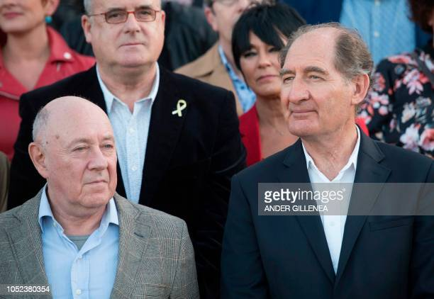 Conflict resolution experts from the International contact group GIC South African lawyer Brian Currin and former Interpol head Raymond Kendall pose...