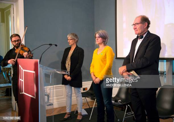 Conflict resolution experts from the International contact group GIC South African lawyer Brian Currin Anais Funosas and Zelai Nikolas observe a...