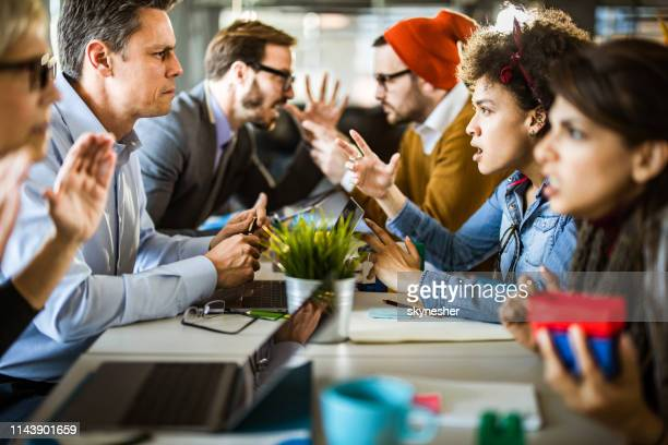 confrontation among business people and creative people! - communication problems stock pictures, royalty-free photos & images