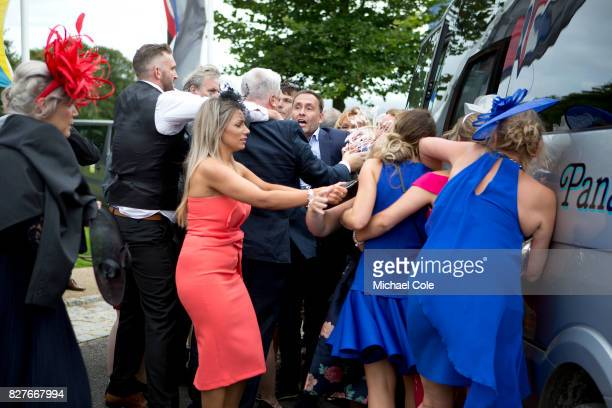 Confrontation as a result of 'queue jumping' for shuttle bus outside main entrance 'Ladies Day' at 'Glorious Goodwood' The Qatar Goodwood Festival at...