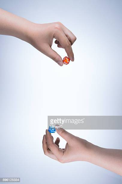 Confrontation between the Two Hands Holding Dice