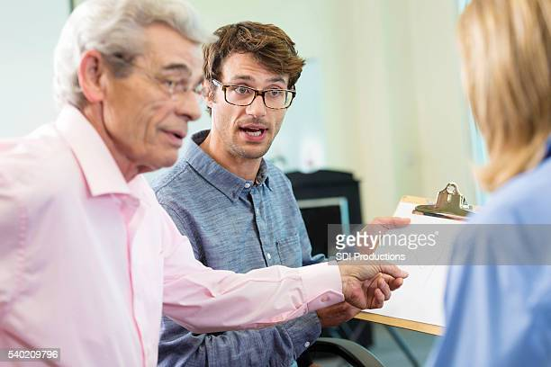 confrontation in the office between boss and employees - prejudice stock photos and pictures