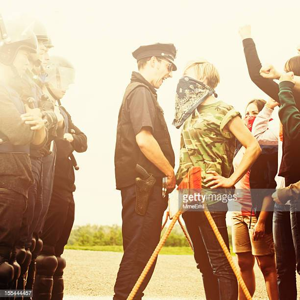 confrontation - protestor stock pictures, royalty-free photos & images