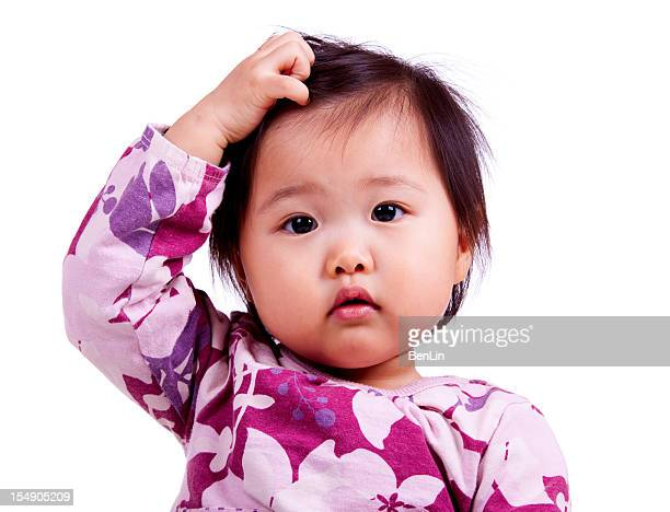 Confused Asian Baby Isolated on White