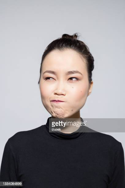 confused asian young woman - izusek stock pictures, royalty-free photos & images