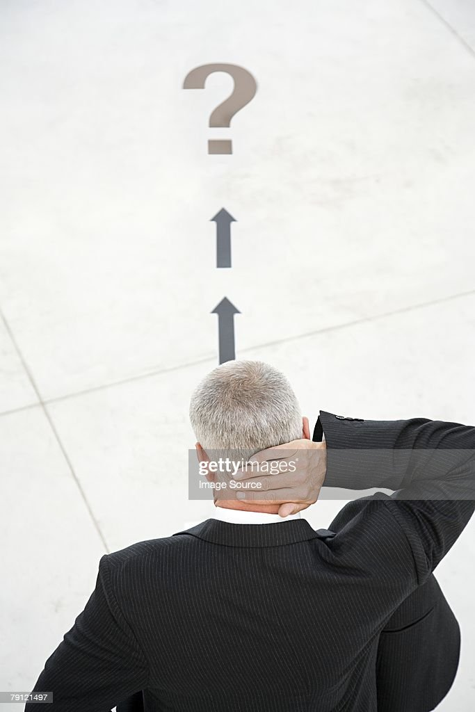 Confused businessman : Stock Photo