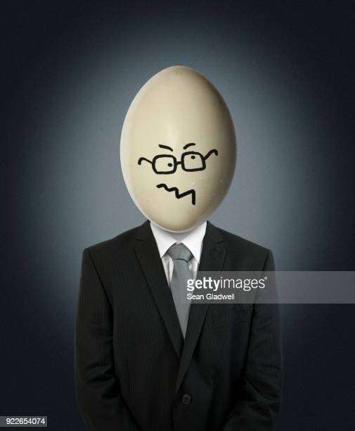 confused egg head businessman - fool stock pictures, royalty-free photos & images