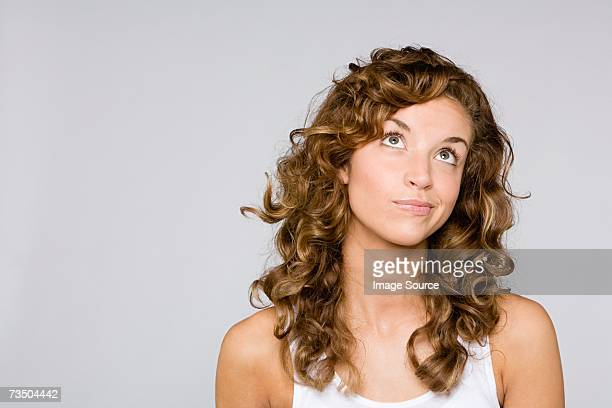 confused looking woman - looking up stock pictures, royalty-free photos & images