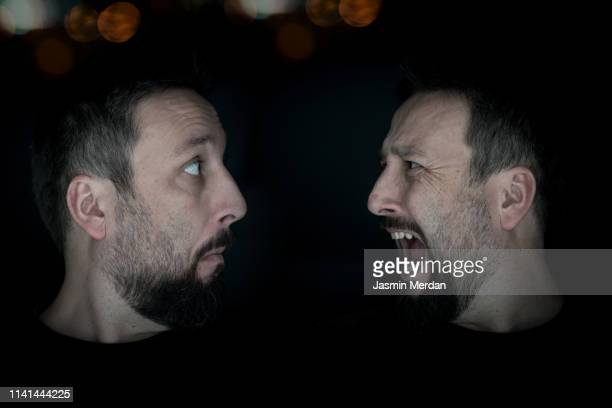 confused man against scared one - cloning stock pictures, royalty-free photos & images