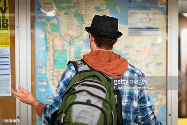 confused man reading city map - fedora stock pictures, royalty-free photos & images