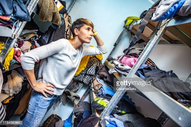 confused mother searching for clothes. - overflowing stock pictures, royalty-free photos & images