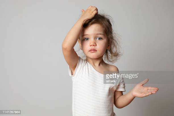 confused toddler - girls stock pictures, royalty-free photos & images