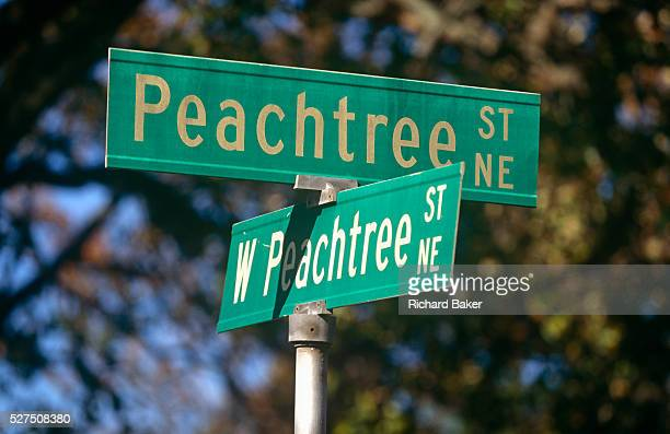 A confusing pair of street signs showing two of the 71 Peachtree street and road names known in Atlanta It is often joked that half of the streets in...