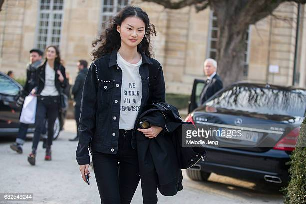 """Cong He wears a """"We Should All Be Feminist"""" Dior shirt at the Dior Couture show at Musee Rodin on January 23, 2017 in Paris, France."""