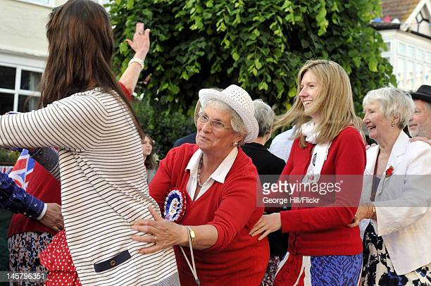 Conga line formed of the residents of Melbourne Road, Wimbledon in South West London during their street party held in celebration of Queen Elizabeth...