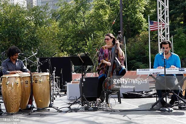 Conga player Yusnier Sanchez bassist Jennifer Vincent and keyboardist Edgar Pantoja Aleman perform together at the Shinnyo Lantern Floating For Peace...