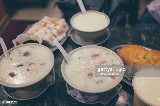 congee , my favourite food in hong kong - congee stock photos and pictures