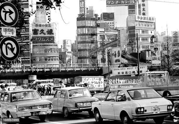 A congested highway through Tokyo is filled with cars buses trucks and pedestrians 5104602RA_Japan114jpg