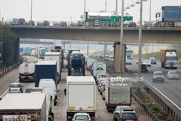 Congested traffic travelling on M1 motorway in Hertfordshire United Kingdom
