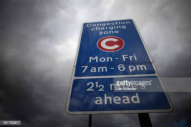 A congestion charge sign stands in Clapham on February 15 2013 in London England The weekday charge was introduced by the then Mayor of London Ken...