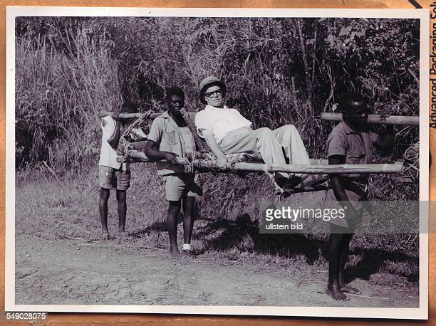 Congo, Africa, Belgian Congo. Belgian administrator being carried through the bush. Historical photo 1950.