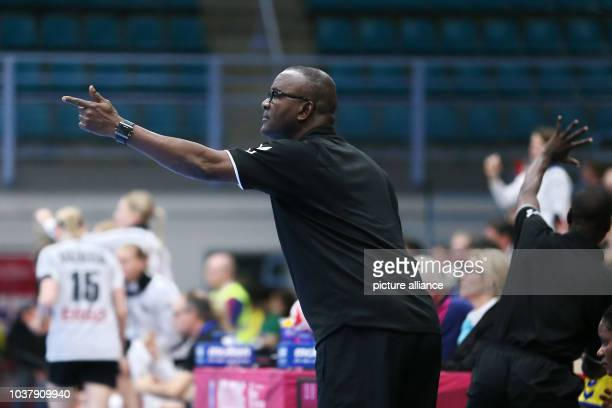 Congo head coach Celestin Mpoua Nkua instructs players during a handball match between Germany and the DR Congo at the IHF Women's Handball World...