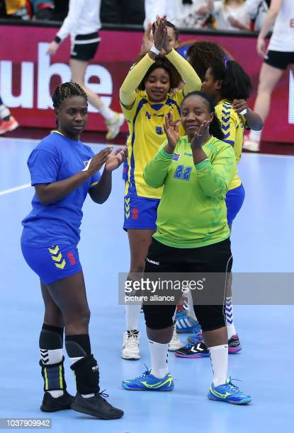Congo players react after a handball match between Germany and the DR Congo at the IHF Women's Handball World Championship in Kolding, Denmark, 11...