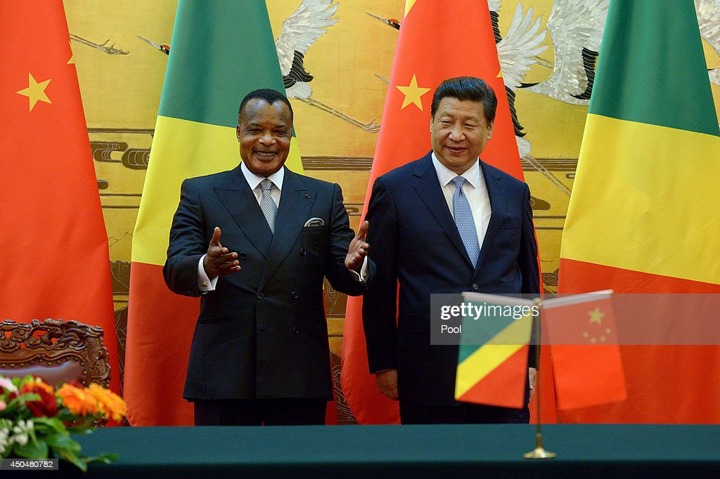 Congo President Denis Sassou N'guesso (L) reacts as he attends a signing ceremony with Chinese President Xi Jinping (R) at the Great Hall of the People in Beijing on June 12, 2014 in Beijing, China. The Congo President is on a visit to China from June 11 to 19.