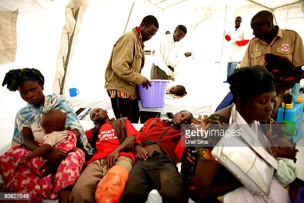 Congolese are treated for cholera in an Medecins Sans Frontieres tent clinic at the Kibati refugee camp November 10 2008 just outside the town of...
