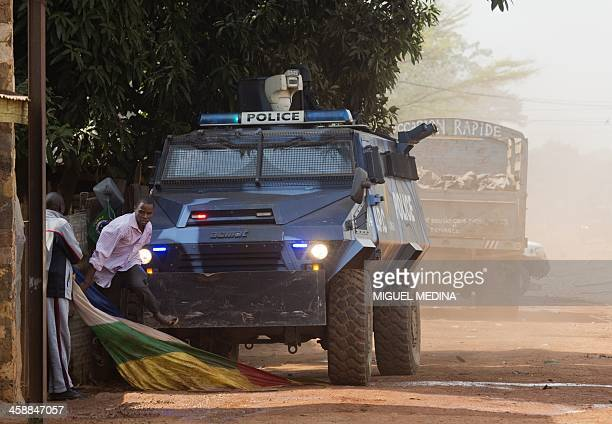 "Congolese armored vehicle of the UPC Congo scatters a protest against the French ""Sangaris"" intervention in the Galabadia neighbourhood close to the..."