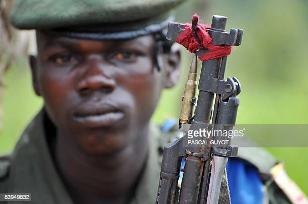 A Congolese army soldier with a bullet fixed to the end of his rifle as a good luck charm is pictured on December 8 2008 some 200 metres from the...