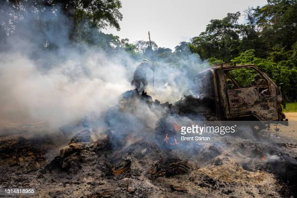 Congolese Army Soldiers and UN troops inspect an ambush site where an hour previously ADF fundamentalist rebels attacked two vehicles on the road...