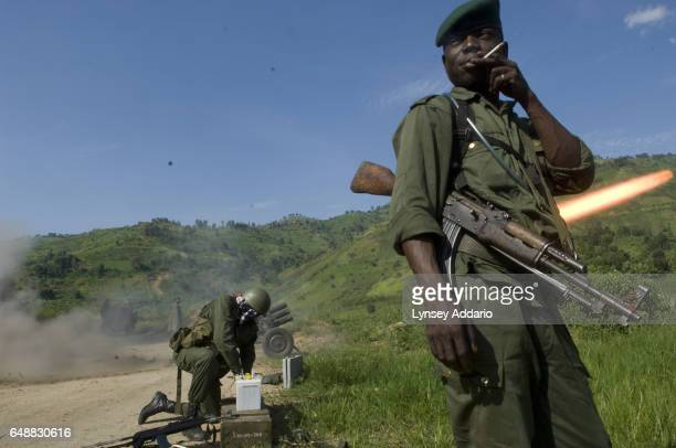 Congolese Army soldiers fire upon Laurent Nkunda's National Congress for the Defence of the People CNDP rebel forces the morning after the Congolese...