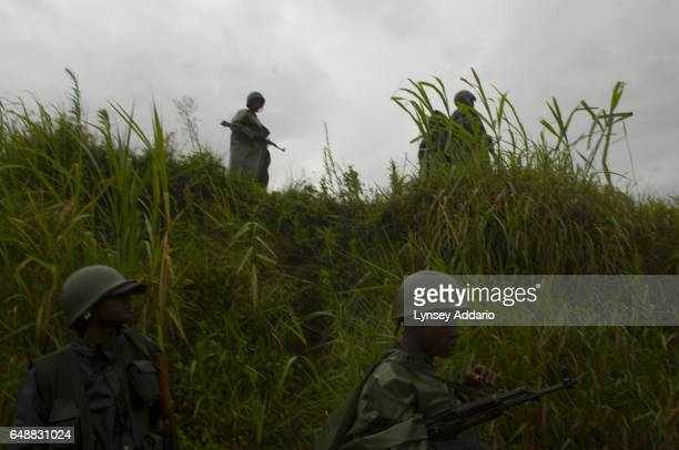Congolese Army soldiers hold a defensive line while fighting Laurent Nkunda's National Congress for the Defence of the People CNDP rebel forces in...