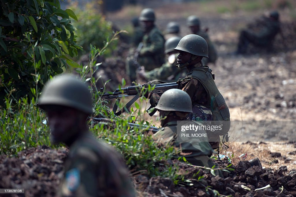 Congolese Army soldiers man a foward position in Kanyarucinya, some 12 kms from Goma, in the east of the Democratic Republic of the Congo on July 16, 2013. The army in the Democratic Republic of Congo on July 16 pursued an offensive against rebels of the M23 movement to protect the North Kivu provincial capital of Goma. M23, a movement launched by Tutsi defectors from the army who accuse the Kinshasa government of reneging on a 2009 peace deal, last year occupied Goma for 10 days before pulling out under international pressure.