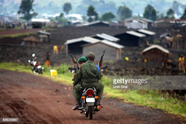 Congolese army soldiers ride a motorbike November 10 2008 on the outskirts of the town of Goma Congo Over 250000 people have been displaced after...