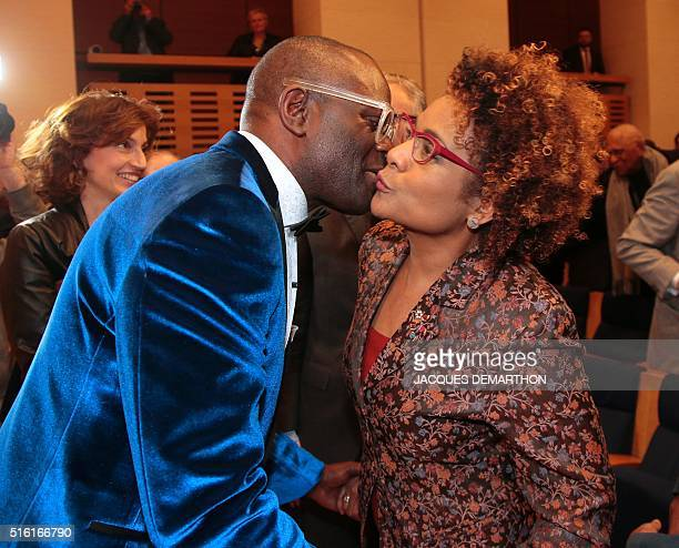 Congolese author Alain Mabanckou kisses Canadian SecretaryGeneral of the International Organisation of La Francophonie Michaelle Jean on March 17...