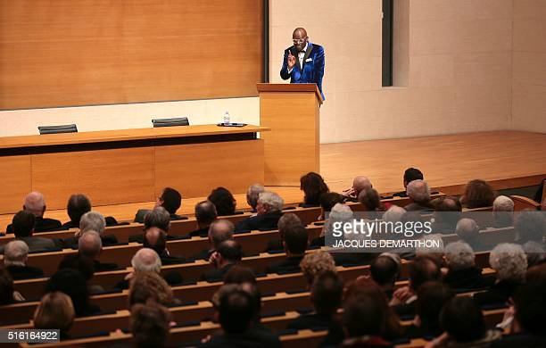 Congolese author Alain Mabanckou speaks on the stage on March 17 2016 at the College de France in Paris during his inaugural lecture the first time a...
