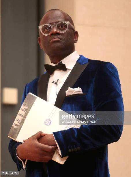 Congolese author Alain Mabanckou stands on March 17 2016 at the College de France in Paris during his inaugural lecture the first time a writer has...