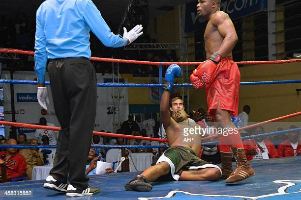 Congolese boxer Cedrick Tshisekedi competes against Kabwiku in the National boxing championships in the Congolese capital Kinshasa, on October 31 to...
