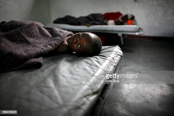 A Congolese boy ill with Cholera is treated in a clinic at the Don Bosko orphanage November 10 2008 in the town of Goma Congo Over 250000 people have...