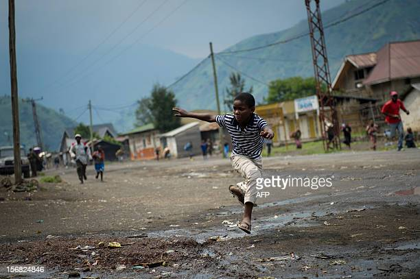 A Congolese boy runs through the town of Sake 26km from Goma as gunfire erupted at the edge of the town in the east of the Democratic Republic of the...