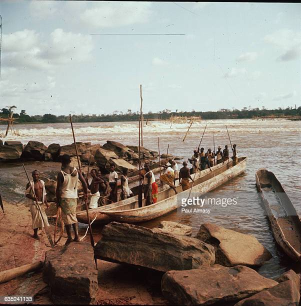 A Congolese canoe that can carry 3040 fishermen through the rapids of the river