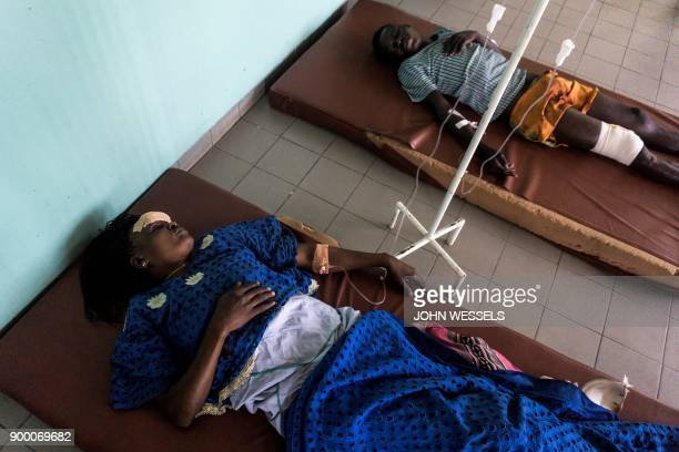 A Congolese Catholic faithful recovers from a rubber bullet wound he received during a demonstration calling for the President of the Democratic...