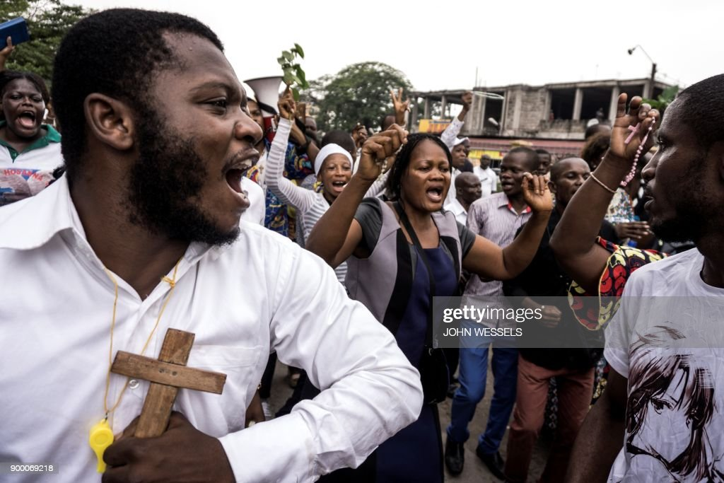 Congolese Catholic faithfuls sing and dance during a demonstration to call for the President of the Democratic Republic of the Congo to step down, on December 31, 2017 in Kinshasa. The protesters are demanding that Kabila promise he will not seek to further extend his time in power in DR Congo, a mostly Catholic former Belgian colony. Kabila has been in power since 2001. Elections to replace him have been delayed and are currently set for December 2018. PHOTO / John WESSELS