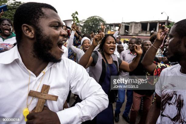 Congolese Catholic faithfuls sing and dance during a demonstration to call for the President of the Democratic Republic of the Congo to step down on...
