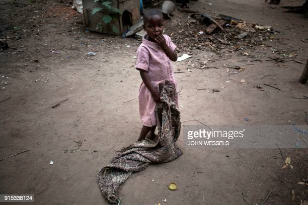A Congolese child is seen at a makeshift orphanage that houses children abandoned or separated from their families in Beni Democratic Republic of the...