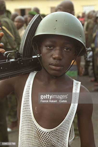 Congolese Child Soldier Carrying AK 47 Rifle